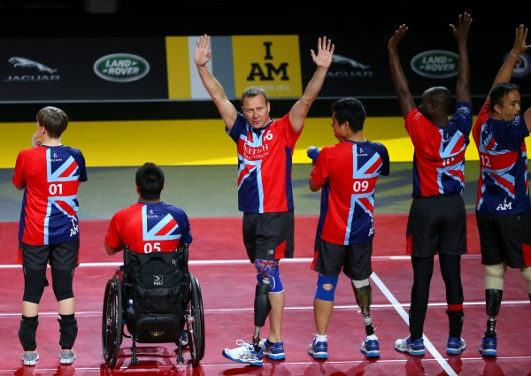 LONDON, ENGLAND - SEPTEMBER 14:  Great Britain players wave to the crowd during the team introductions before the Sitting Volleyball Semi Final between United Kingdom and Georgia at the Copper Box Arena on day four of the Invictus Games, presented by Jaguar Land Rover at Queen Elizabeth Olympic Park on September 14, 2014 in London, England.  (Photo by Paul Thomas/Getty Images for Jaguar Land Rover).